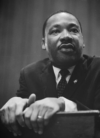 348px-Martin-Luther-King-1964-leaning-on-a-lectern (1)