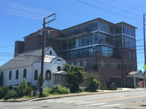 The former Temple Beth Hatfiloh building (now K Records) with the Washington health care exchange in the background.