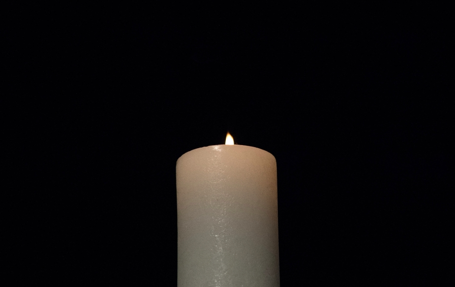A_ceremonial_candle_was_lit_and_burns,_during_the_2013_Federal_Inter-Agency_Holocaust_Remembrance_Day,_at_the_Lincoln_Theater,_on_Wednesday,_April_17,_2013,_in_Washington,_D.C.